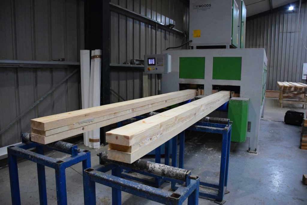 sawn redwood, glued and pressed together being put through the Radio Frequency machine
