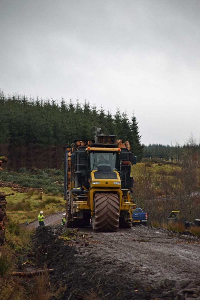 9205 Terragator with a Kesla 2012T loader driving down forest road