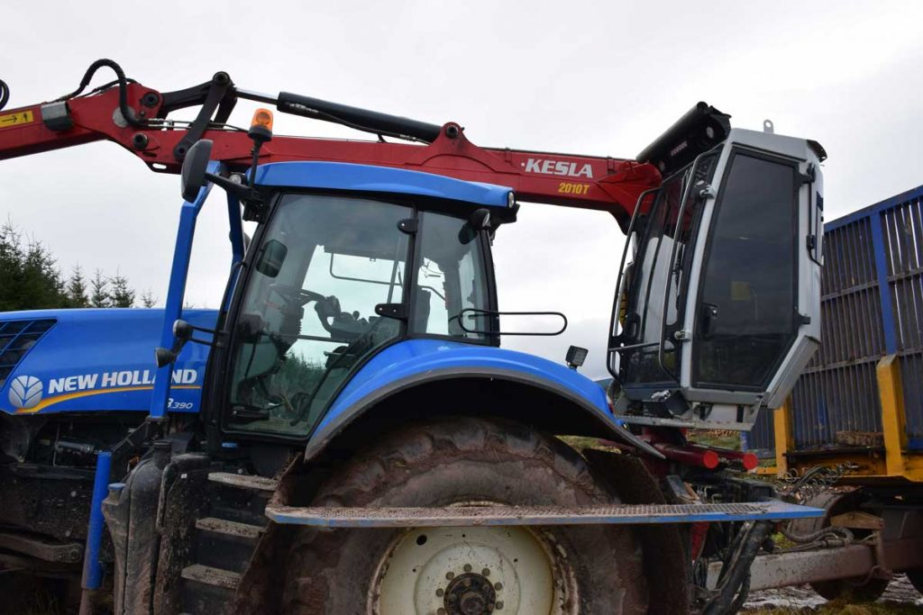 New Holland tractor with a Kesla 2010T loader and low ground pressure trailer