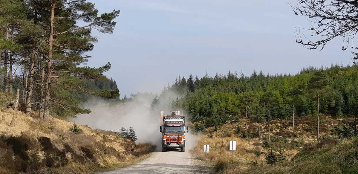 Sustainable transport - Low ground pressure timber haulage truck on forest road