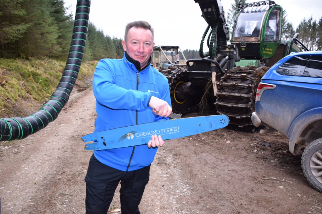 Ian Lawrence demonstrating how to maintain a harvester guide bar
