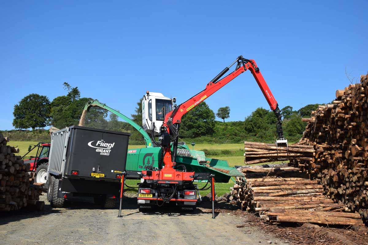 Jenz HEM 561 chipper mounted on a Scania G450 chipping wood for biomass