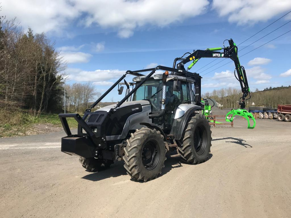 latest forestry equipment for sale - Valtra M130 with Botex 570 Roof mounted Loader