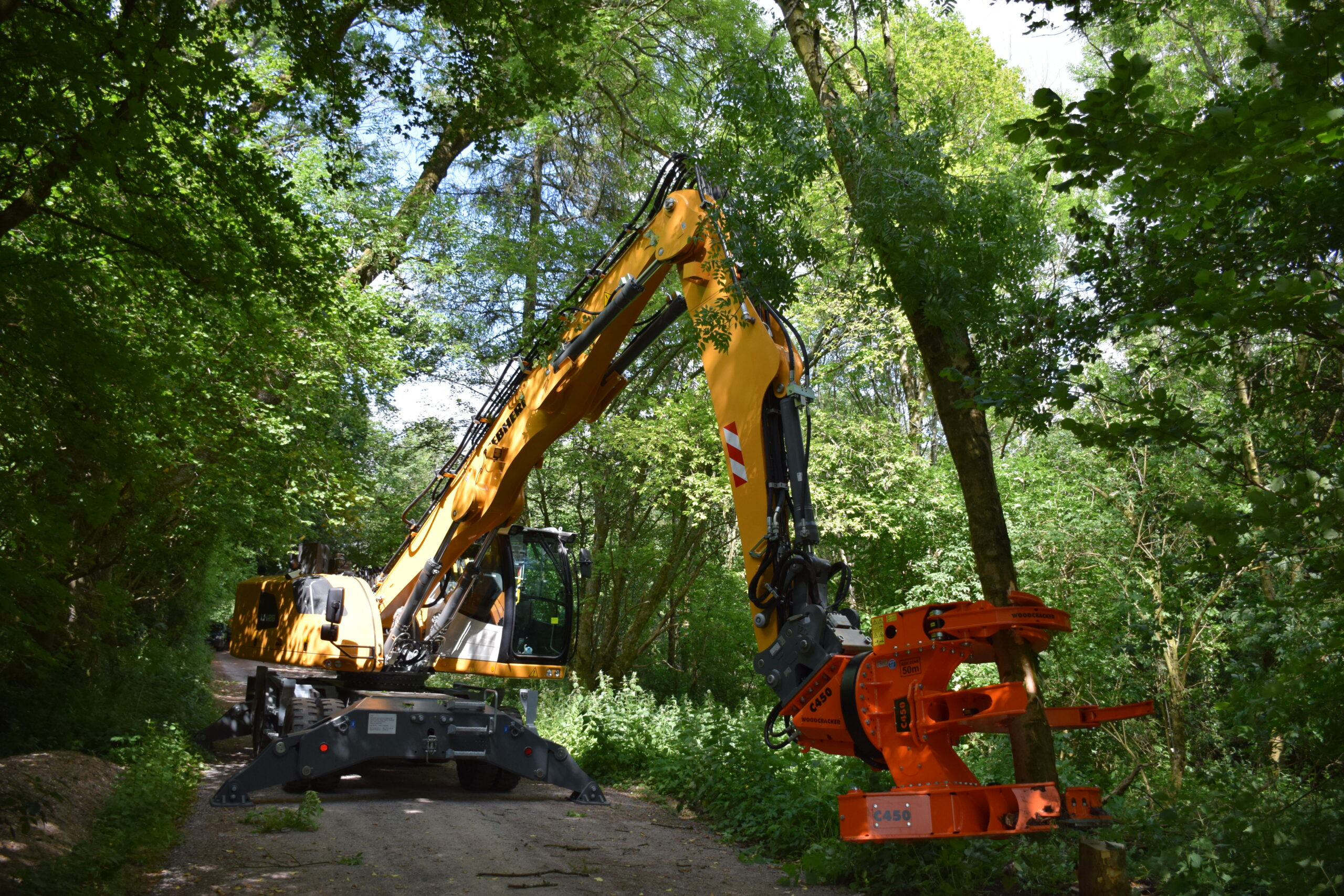 Tackling Ash Dieback with a Liebherr LH 26 Rubber Duck Excavator with hi lift cabin fitted with a C450 Woodcracker®