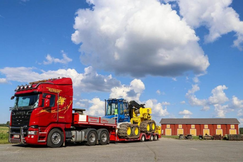 Red Scania lorry loaded up with specially built Rottne F12 de-bogging forwarder,