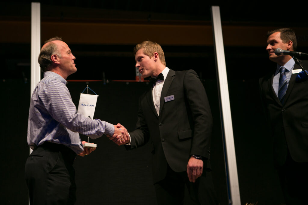 James V Stronach receiving an award at Alucar's 30th anniversary party.