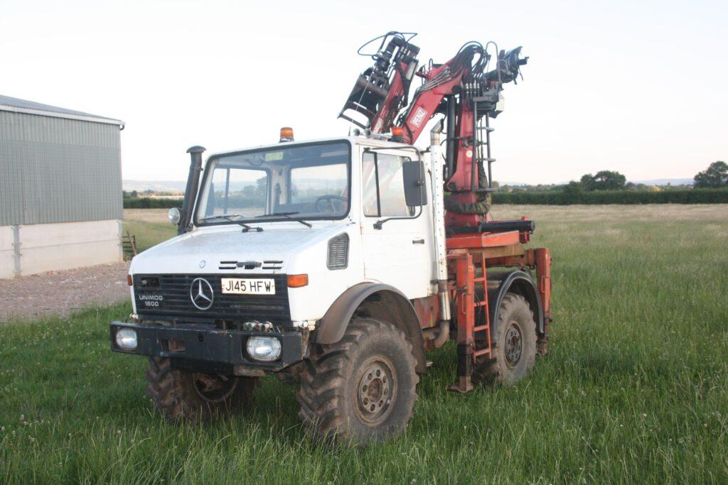 Unimog with Penz 5500 HL Z Crane