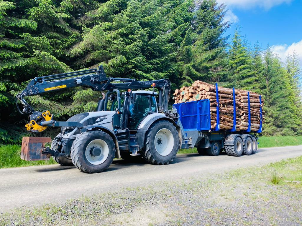 Howie Forestry Solutions - Valtra with crane mount and trailer made by Adam.